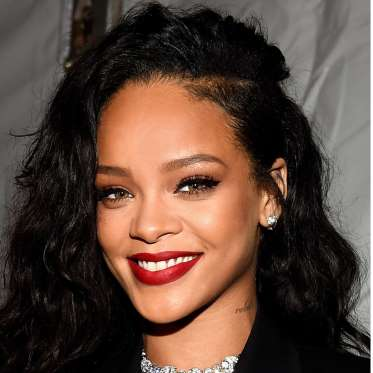 1. Rihanna's Side-Parted -Long-Waves