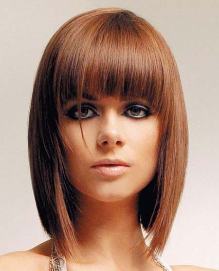 shoulder hairstyle with blunt bangs for women
